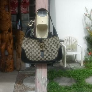 Vintage Gucci front is perfect and has bag